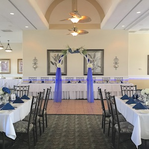 gator trace wedding arch and tables