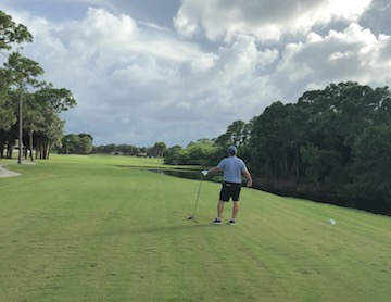 golfer on gator trace hole 18 tee